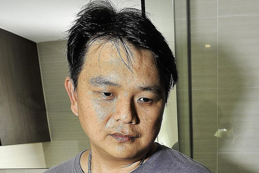 Mr Fabian Tan (above) and his family have not been able to use the master bedroom toilet for a month after workers hacked the toilet walls to trace the source of the stench. Mr Tan first noticed the stench when he moved into his RiverParc Residence u