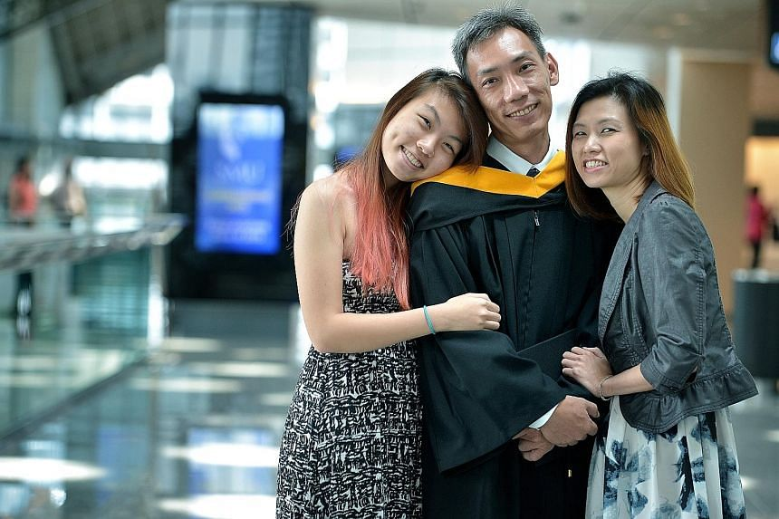 Senior military expert Eugene Low with his daughter, Daphne, 18, and his wife, Mrs Irene Low (far right), 44. Mr Low, who has 24 years of working experience with the SAF, said studying alongside peers 20 years his junior proved to be a challenge at f