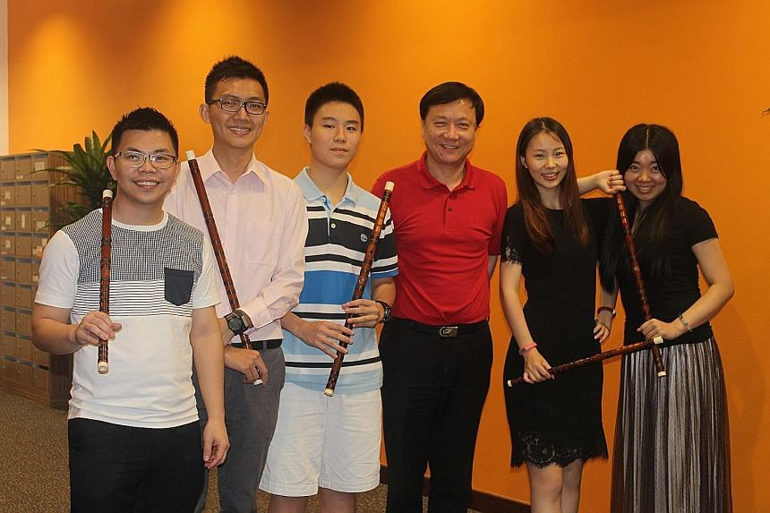 Festival artistic director Zhan Yongming (in red polo shirt) with some of his students who will be performing with him on Saturday, and Mr Tan Qinglun, the festival's director (second from left).