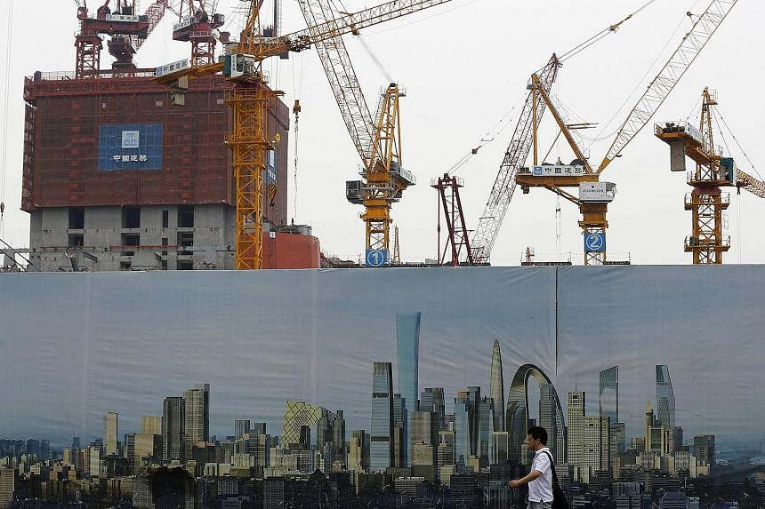 A construction site in Beijing. China's National Bureau of Statistics yesterday said the economy grew 7 per cent in the second quarter, better than economists' estimates of 6.8 per cent. Some analysts questioned the accuracy of the data, implying tha