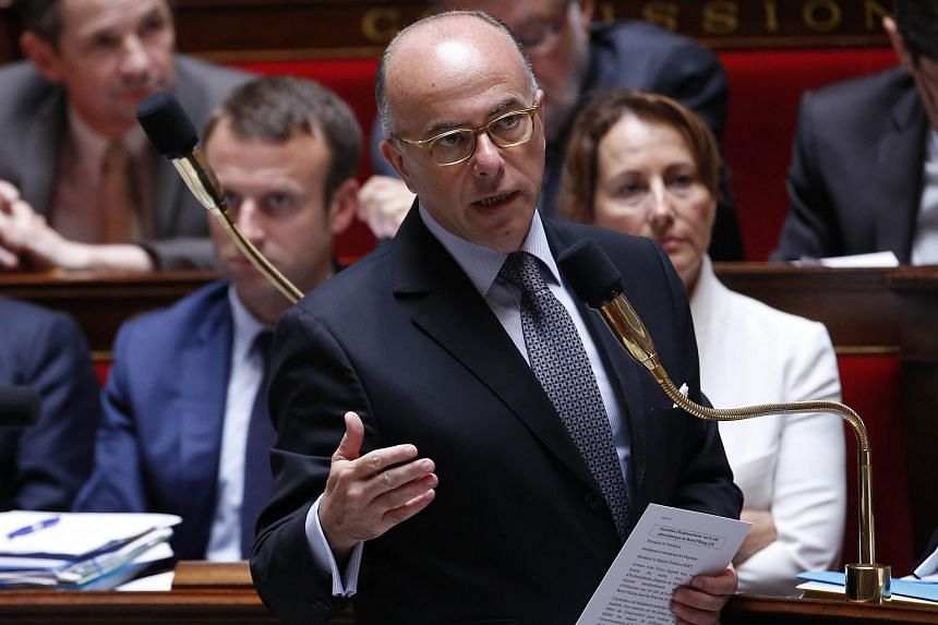 French Interior minister Bernard Cazeneuve speaks during a session of Questions to the government at the National Assembly in Paris on July 15, 2015.
