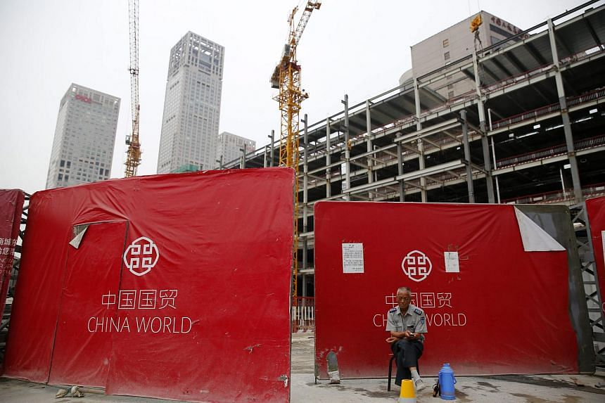 A security guard outside a construction site in Beijing.