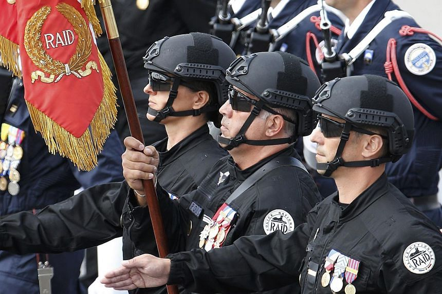 Members of French Raid forces marching at the Bastille Day military parade in Paris on July 14.