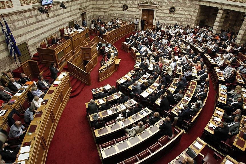 Greek Prime Minister Alexis Tsipras (centre) addresses the members of the parliament during a parliamentary session in Athens, Greece, on July 15, 2015.