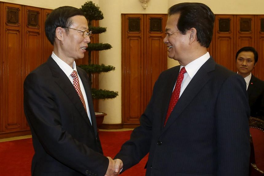 China's Vice-Premier Zhang Gaoli (left) shakes hands with Vietnam's Prime Minister Nguyen Tan Dung before their meeting at the Government Office in Hanoi on July 16, 2015.