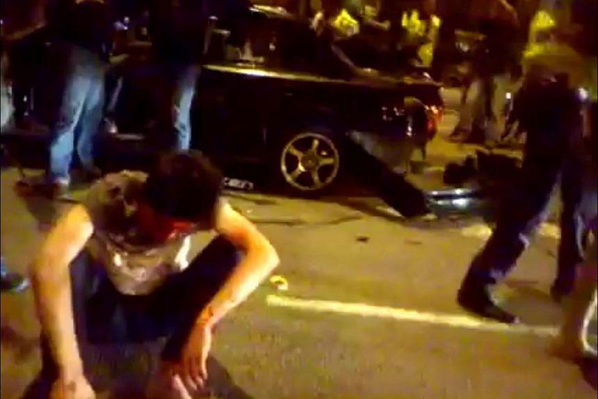 An injured man during the riot at Low Yat Plaza in Bukit Bintang, Kuala Lumpur.