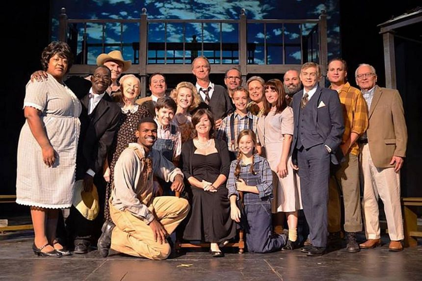 Mary Badham (centre) with the cast of a production of To Kill A Mockingbird in 2013 at the Virginia Samford Theater in Birmingham.