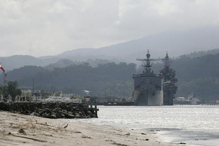 US warships are seen docked at Subic bay in Olongapo city, north of Manila, the Philippines on October 14, 2014.