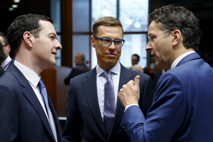 Britain's Chancellor George Osborne (left), Finland's Finance Minister Alexander Stubb (centre) and Dutch Finance Minister and Eurogroup President Jeroen Dijsselbloem meet in Brussels on July 14, 2015.