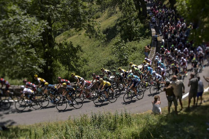 Participants riding during the 188 km eleventh stage of the 102nd edition of the Tour de France cycling race, between Pau and Cauterets, south-western France on July 15, 2015.