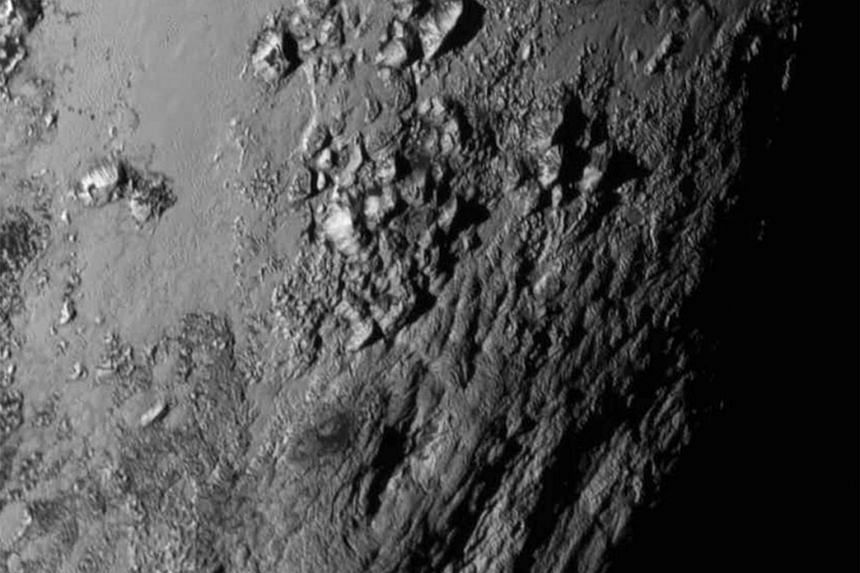 This July 15, 2015, image from NASA shows a region near Pluto's equator with a range of youthful mountains.