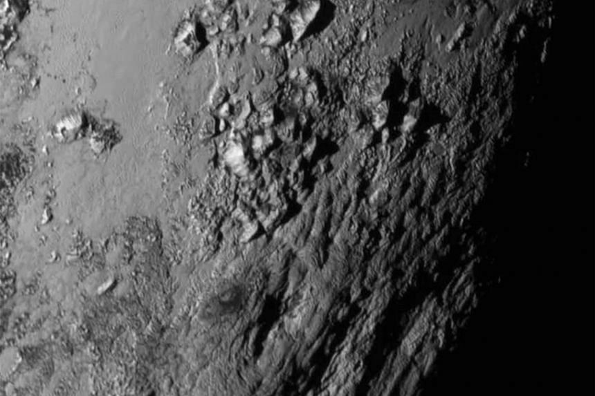 A close-up image of a region near Pluto's equator reveals a giant surprise: a range of youthful mountains.