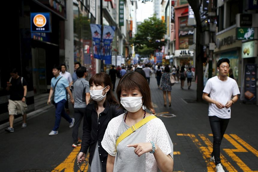 People wearing masks in Seoul's Myeongdong shopping district on July 9.