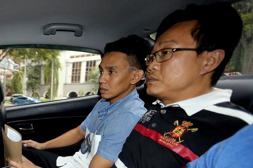 Ho Yueh Keong (right), who had been on the run for nine years, is charged with harbouring Tan Chor Jin, who had killed a nightclub owner in 2006. Ho allegedly helped Tan flee the law after the murder.