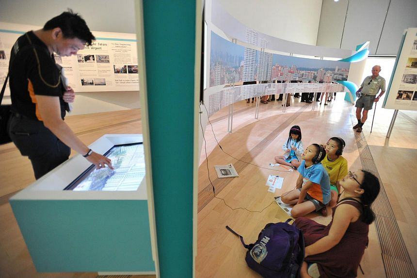 Singapore STories: Then, Now, Tomorrow, an exhibition featuring stories and photographs from the newspaper's archives since its launch in 1845, opened to the public on Friday morning, July 17, 2015.