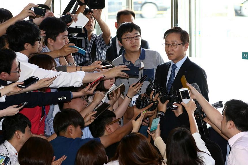 Shin Kim, co-chief executive officer of Samsung C&T Corp., right, speaks to members of the media as he arrives for the company's extraordinary shareholders' meeting in Seoul, South Korea, on Friday, July 17, 2015.