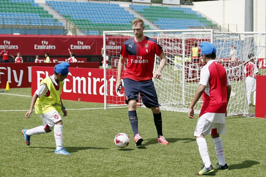 Young fans aged from six to 12 got to meet and learn from Arsenal's stars at the Emirates Football Clinic on July 17, 2015.