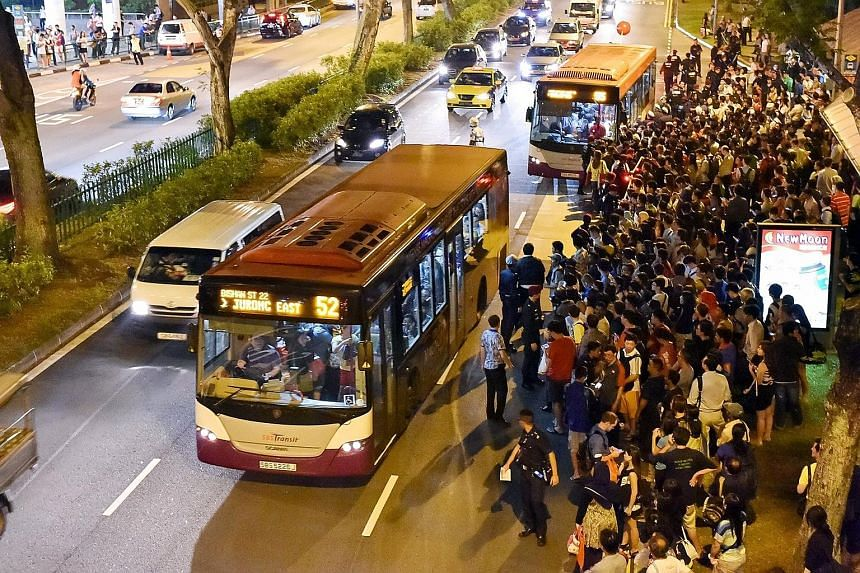 A big crowd waiting to board buses near Bishan MRT station on July 7. The North-South and East-West Lines were shut down for more than two hours during the evening rush hour, affecting more than 250,000 commuters. More buses were activated to ply the