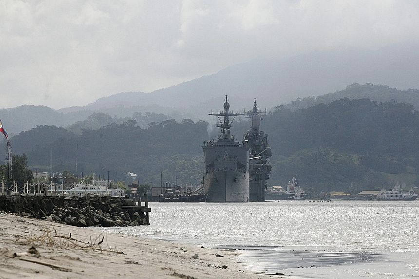 US warships docked at Subic Bay in the Philippines last October. US Navy ships have called regularly at Subic Bay since 2000, but only during exercises with the Philippine military or for repairs and resupply.