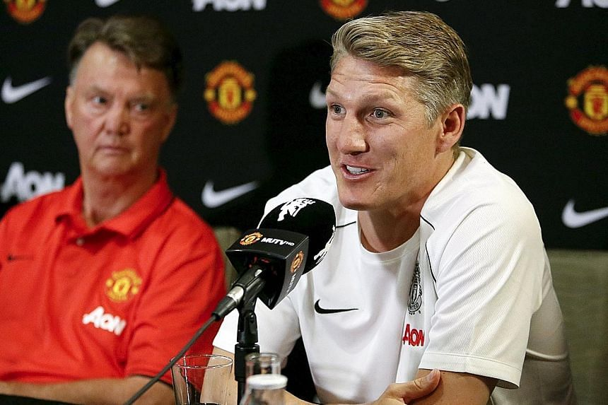 Bastian Schweinsteiger (right), with manager Louis van Gaal, brings plenty of experience to Manchester United from his years as a stalwart with Bundesliga champions Bayern Munich and World Cup holders Germany. But van Gaal has told his new signings t