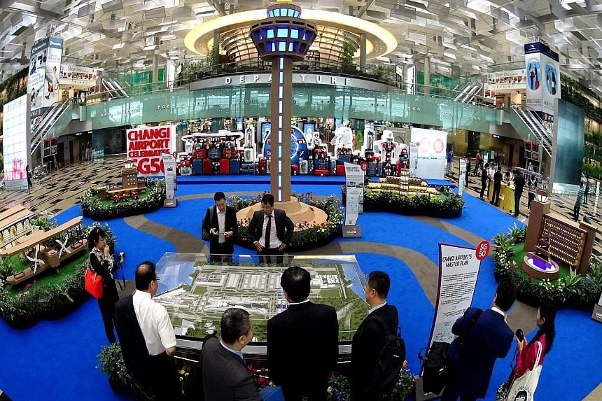 The exhibition area at Terminal 3 showcases Singapore's aviation history. The Changi Airport masterplan is on public display for the first time.