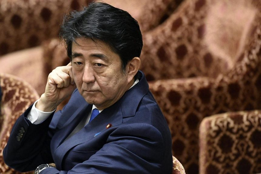Japanese Prime Minister Shinzo Abe attends a committee session debating the security bills at the parliament in Tokyo, Japan on July 15, 2015.