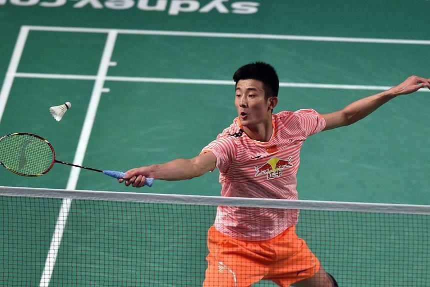 Chen Long returns a shot to Denmark's Viktor Axelsen during the men's singles final at the Australian Open badminton tournament in Sydney on May 31, 2015.
