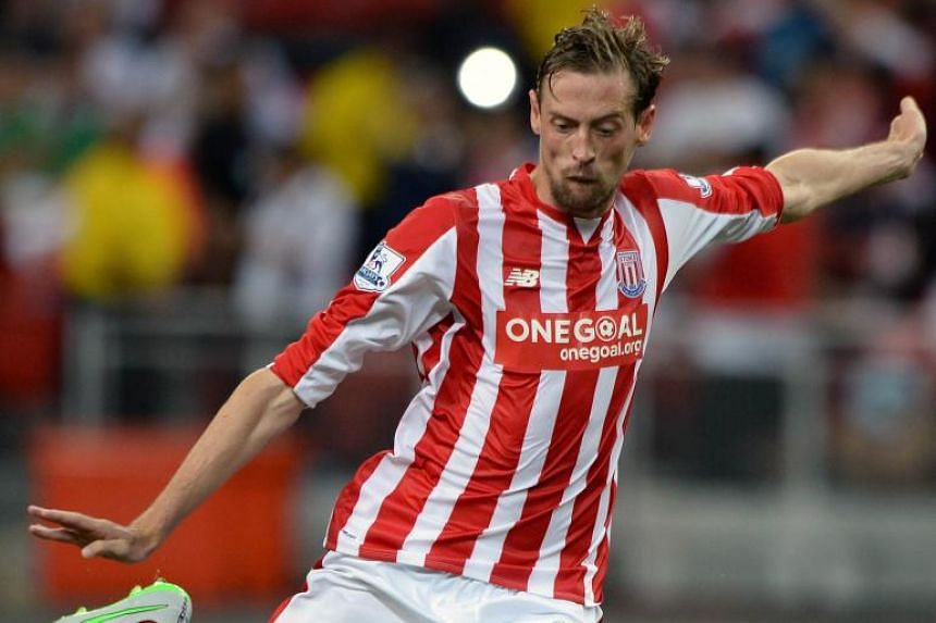 Stoke City's Peter Crouch takes a penalty shot against Everton during their Barclays Asia Trophy football match at Singapore National Stadium in Singapore on July 15, 2015.