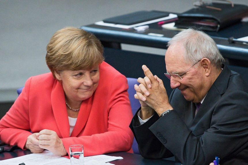 German Chancellor Angela Merkel (L) and German Finance Minister Wolfgang Schaeuble during a special session of the German Bundestag over the proposed bailout package for Greece, in Berlin, Germany, on July 17, 2015. PHOTO: EPA