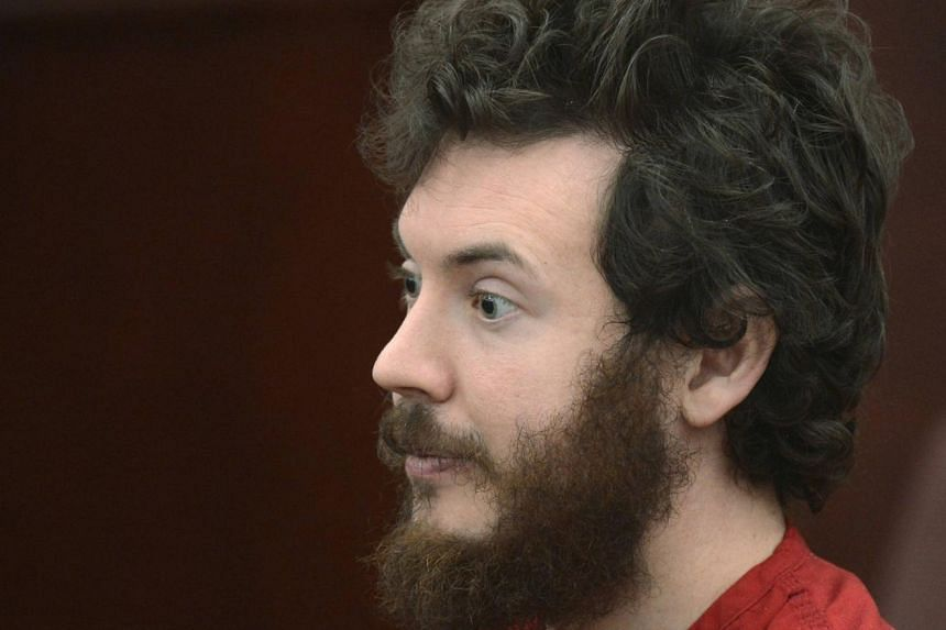 James Holmes listens during his arraignment in Centennial, Colorado in this March 12, 2013 file photo.
