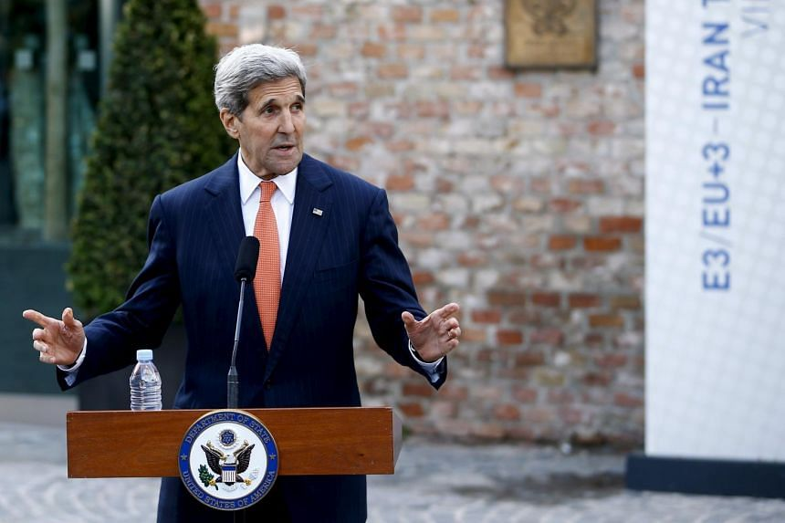 U.S. Secretary of State John Kerry talks to journalists in front of Palais Coburg, the hotel where the Iran nuclear talks meetings are being held in Vienna, Austria July 9, 2015.