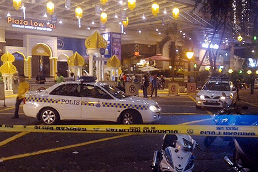 Five people were injured including two journalists in a mob attack near Low Yat Plaza after police dispersed protesters at the shopping mall.