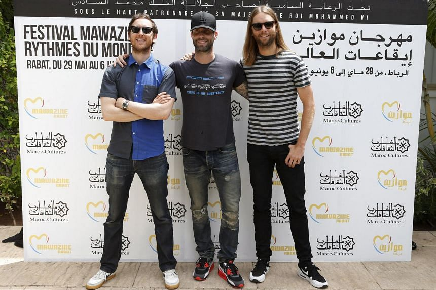 Members of pop rock band Maroon 5 pose during a photocall at the 14th Mawazine World Rhythms International Music Festival in Rabat on June 6, 2015.