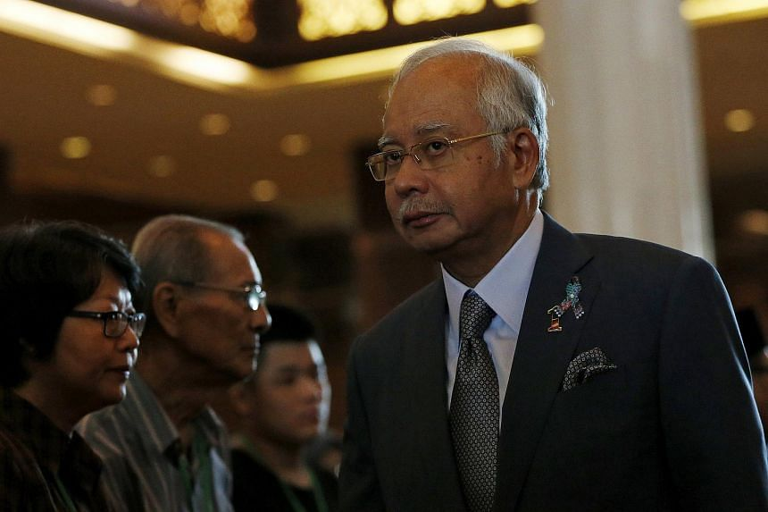 Malaysian PM Najib Razak greeting family members of MH17 victims during a memorial service to mark the first anniversary of the disaster.