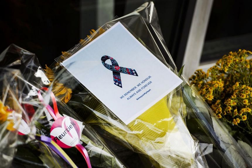 Flowers were laid in front of the departure hall 3, at the airport in Schiphol, the Netherlands, on July 17, 2015, in memory of the people who died in the crash of Malaysian Airlines flight MH17 a year ago.