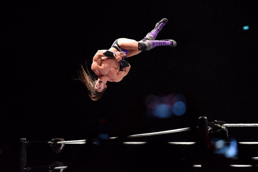 Billed as the man gravity forgot, Neville performs his awe-inspiring Red Arrow finisher at the Singapore Indoor Stadium on July 2, 2015.