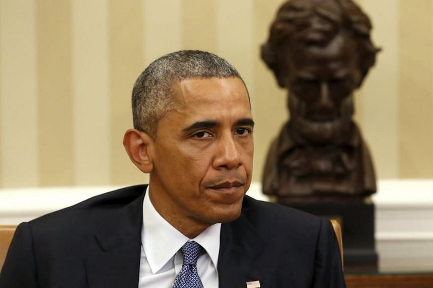 US President Barack Obama talks to the media in the Oval Office in Washington about the shootings.