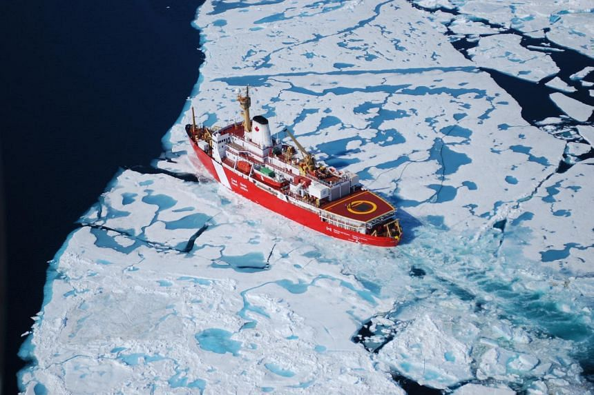 A ship passing through the ice in the Arctic.