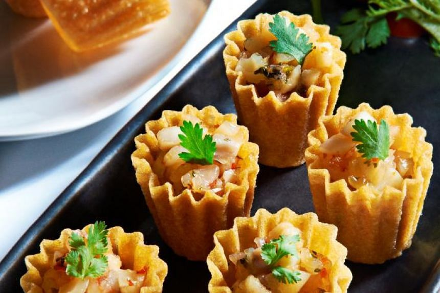 Hotel Fort Canning will offer free local food like mixed seafood kueh pie tee.
