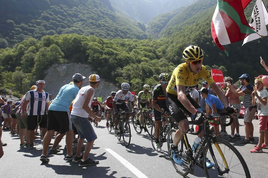 Chris Froome (right) climbing during the 11th stage of the Tour de France on Wednesday. The Briton, who maintained his grip on the yellow jersey, later challenged his detractors to prove that he has been doping.