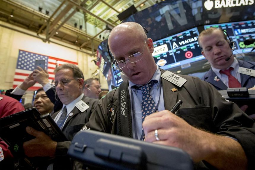 Traders work on the floor of the New York Stock Exchange July 16, 2015.
