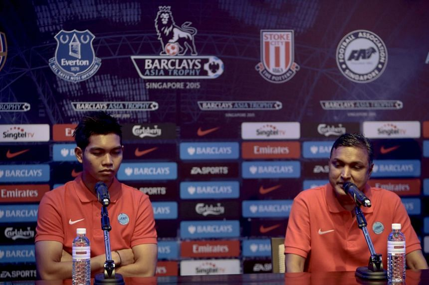 Singapore Selection goalkeeper Izwan Mahbud (left) and team manager V. Sundramoorthy (right) speak to journalists at a press conference ahead of the Barclays Asia Trophy soccer tournament in Singapore, July 14, 2015.