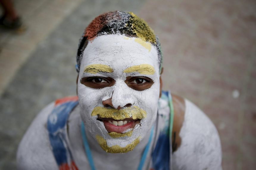 A tourist poses for photographs during the Boryeong Mud Festival at Daecheon beach in Boryeong, South Korea on July 18, 2015.