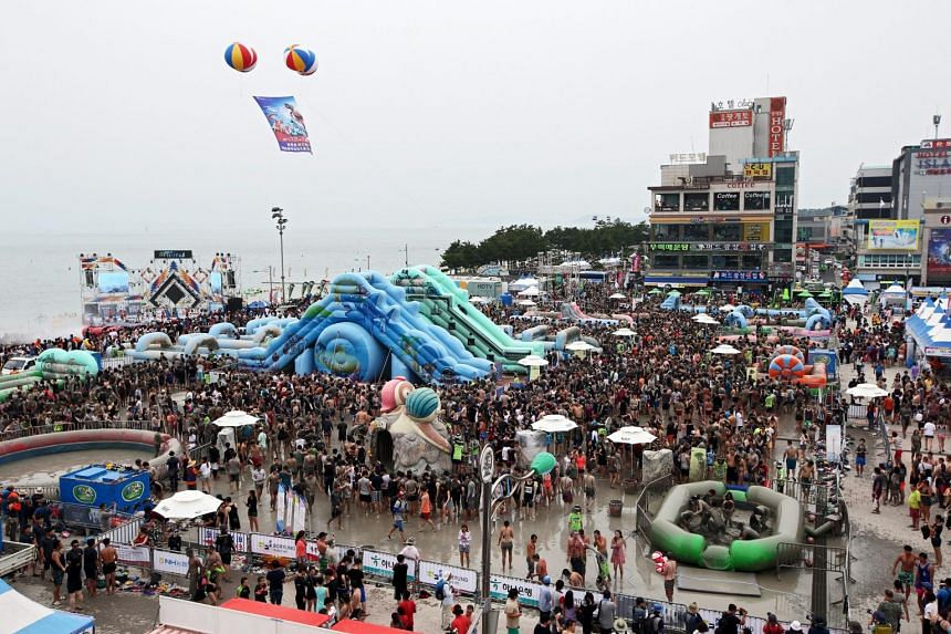 Festival-goers take a bath in a mud pool during the 18th Boryeong Mud Festival on Daecheon beach in Boryeong City, South Korea on July 18, 2015.