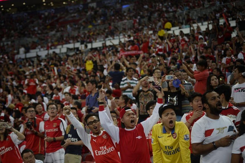 Arsenal fans cheer during the Barclays Asia Trophy final between Arsenal and Everton on July 18, 2015.