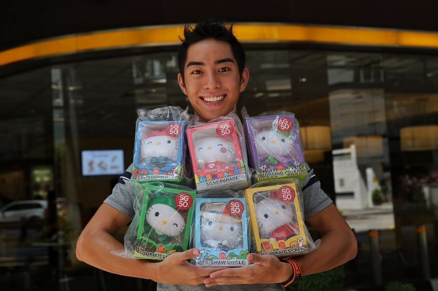 23-year-old Andreas Toh holds up the six different designs from the limited edition SG50 Hello Kitty set. His winning entry was an old photograph of him when he was four years old posing with the Ronald McDonald statue at King Albert Park McDonald's.