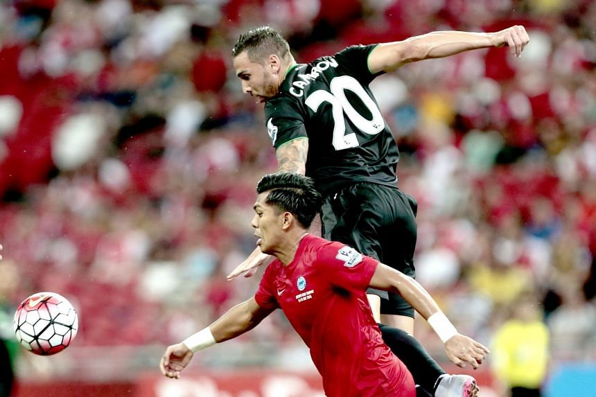 Stoke City's Geoff Cameron (right) in action against Singapore Selection's Khairul Amri (left) during the Barclays Asia Trophy match between Stoke City FC.