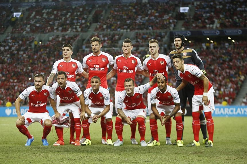 Arsenal players line up before the Barclays Asia Trophy soccer match between Arsenal FC and Everton FC.