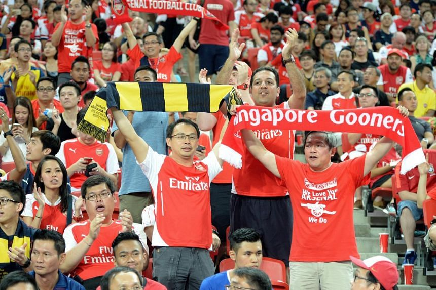 Everton and Arsenal fans at the National Stadium.
