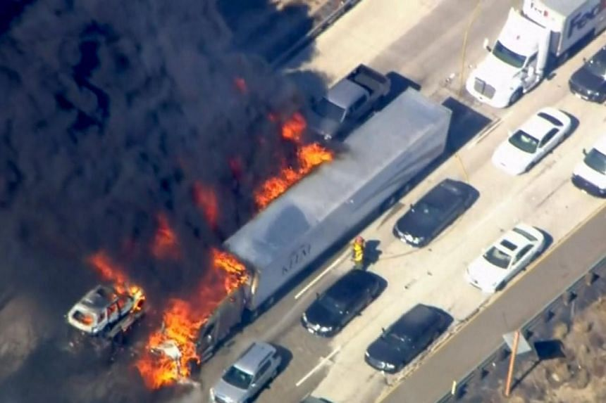 Cars are shown burning on the Interstate 15 freeway in the Cajon Pass, California in the frame grab from KNBC video on July 17, 2015.